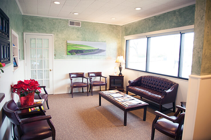 Thumbnail of comfortably furnished plush dental patient waiting area