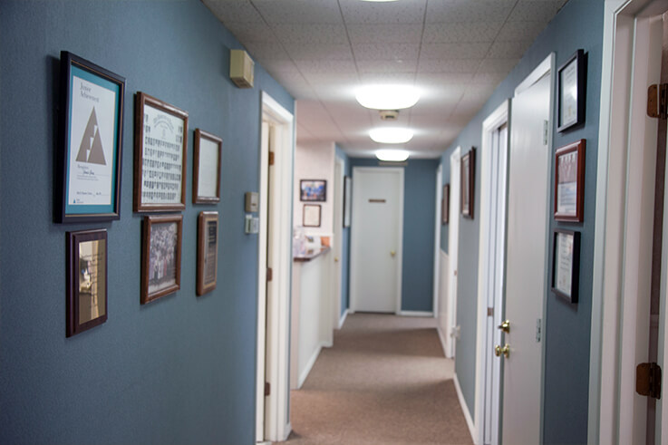 Thumbnail of clean, well-lit hallway leading to treatment rooms