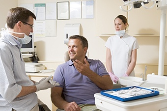 Man talking to dentist in dental chair