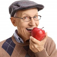 Older man biting into an apple