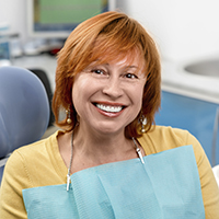 Female patient smiling in dental chair