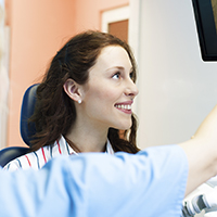 Young female patient looking at computer monitor
