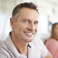 Older male patient with attractive smile