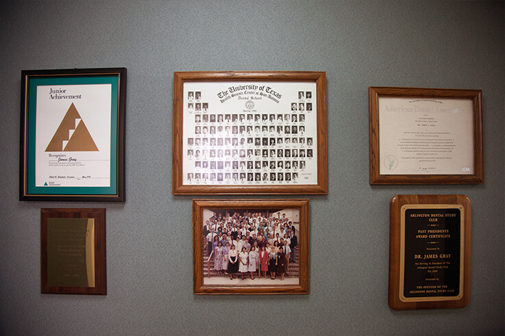 Wall displaying Dr. Gray's training and educational achievements