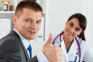 Man giving thumbs up at dental office
