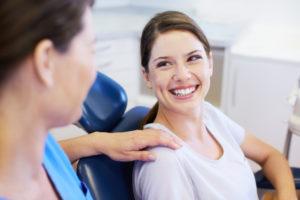 Woman in dental chair smiling at Arlington dentist