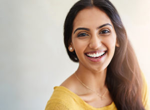 Woman with beautiful smile following teeth whitening