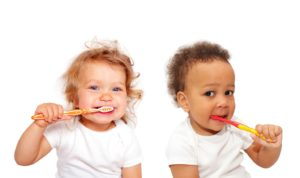 toddlers with toothbrushes