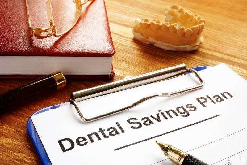 clipboard with Dental Savings Plan information